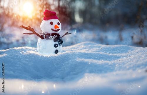 Leinwanddruck Bild snowman on orange sunset background christmas santa