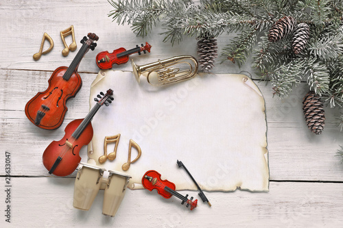 Christmas tree branches with music instruments on wooden background  - 236330147