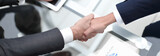 close up. investor and businessman shaking hands - 236339148