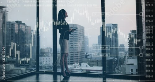 Conceptual shot of businesswoman with infographics digital composite