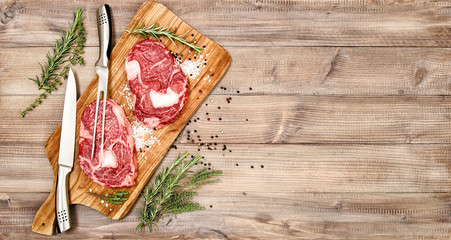 Raw beef steak rib eye meat herbs spices Food background