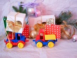 Bright toy toys deliver boxes with gifts, Christmas decorations, New Year's decor, balls on a light background, concept of congratulations on seasonal winter holidays, Christmas, New Year, home interi - 236349392