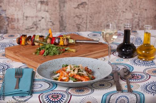 shrimp pasta and grilled vegetables on skewers - 236361753