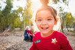 Cute Mixed Race Baby Girl Christmas Portrait With Family Behind Outdoors
