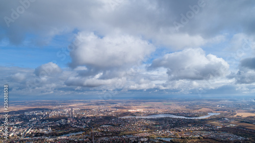 View from the height of the city through the clouds - 236388538