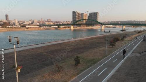 Man riding bike near Danube river in Belgrade