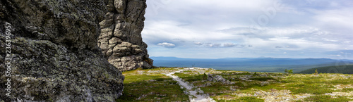 Magnificent panorama of the stone idols of Manpupunyor in the Northern Urals of Russia. Panoramic view of the miracle of Russia. - 236396957