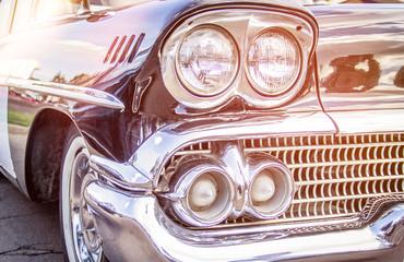 Retro car.Close-up of headlights of vintage car. Exhibition.Vintage car headlights
