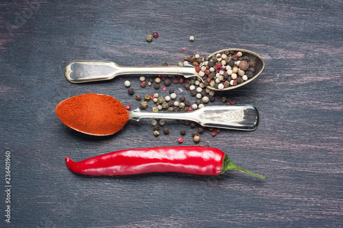 colored peppers mix  in spoon,  red chili pepper .