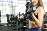 woman exercising in fitness gym. - 236408981