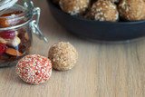 Energy bites from dates, cashew, raisins, cranberry and almond on light wooden table - 236422505