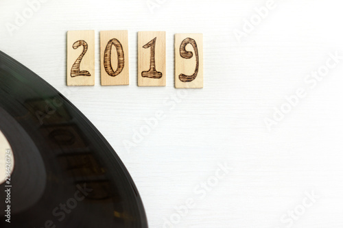The old music plate and plates with the number 2019 on a light surface retro music for the New Year mood - 236426724