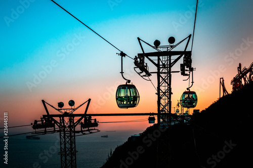 Leinwandbild Motiv View of a cable car at sunset