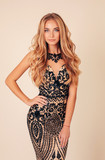 beautiful woman with long blond hair in luxurious evening dress - 236452574