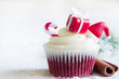 Leinwanddruck Bild - Christmas cupcake with holiday ornament and cinnamon on white background