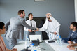 Leinwanddruck Bild - Arabian partner handshake with businessman.