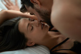 passionate lovers man and woman making love in bed.