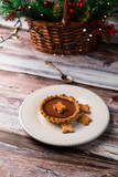 homemade chocolate tartlet, on a white plate, colorful backdrop