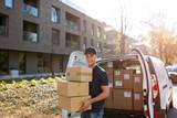 Delivery man standing in front of his van - 236488977