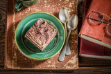Closeup of homemade chocolate cake on old books - 236505702