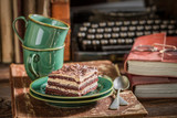 Rustic chocolate cake and coffee with books and typewriter - 236505713