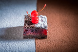 Closeup of delicious chocolate cake with crumble and cherry - 236505722