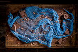 Chocolate bar and textile as blue and brown background - 236505941