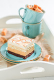 Closeup of toffee cake with fudge bars on blue porcelain - 236505953