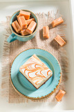 Top view of toffee cake with bars on blue porcelain - 236505978