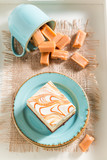 Top view of yummy toffee cake on blue porcelain - 236505982