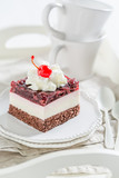 Closeup of sweet jelly cherry cake with cream and cherries - 236505997