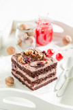 Closeup of fresh chocolate cake with cherries and nuts - 236506719