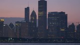 Chicago - April 2017: Illuminated panning motion view at sunset of Sears Tower city Skyscrapers and skyline Lake Michigan Illinois USA RED EPIC  - 236540743