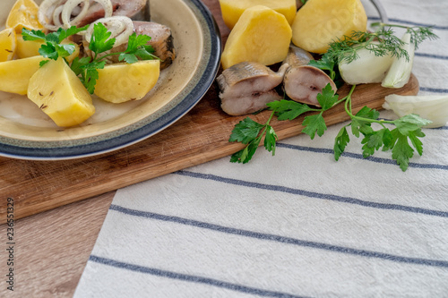 Sliced fish with potatos on plate - 236551329