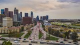 Aerial time lapse of Los Angeles freeway with tall buildings and traffic - 236568900