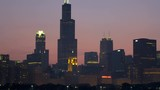 Chicago - April 2017: Panning motion view at sunset of illuminated Willis Tower city Skyscrapers and skyline Lake Michigan Illinois USA RED EPIC  - 236575170