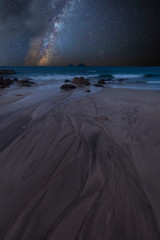 Vibrant Milky Way composite image over landscape of Beautiful beach © veneratio