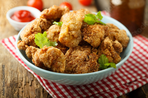 Homemade chicken nuggets with tomato sauce - 236595182
