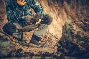 Geologist Checking the Soil © Tomasz Zajda