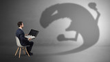 Young businessman staying and  negotiate with a monster shadow  - 236599922
