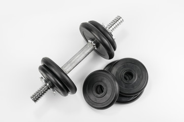 Dumbbells top view on grey background © azure