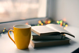 Cup of coffee with books on blurred bokeh background - 236643570