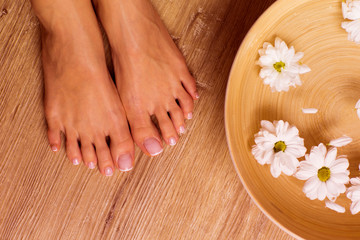 The picture of ideal done manicure and pedicure. Female hands and legs in the spa spot. © forma82
