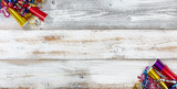 Happy New Year Celebration with party objects in right and left corners on white rustic wooden boards