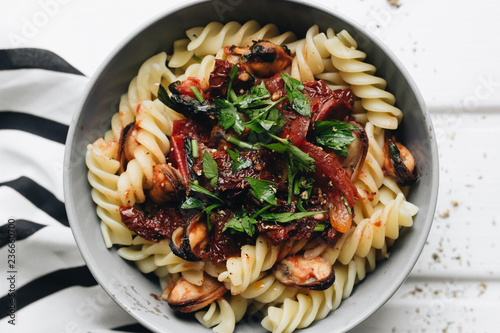 Delicious pasta with tomatoes, mussels and herbs - 236660700
