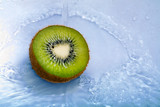 Juicy kiwi fruit in water splash. Beautiful wallpaper.
