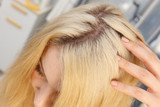 Woman showing blonde hair roots