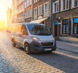 minivan in the ancient center of the European city © Yuri Bizgaimer