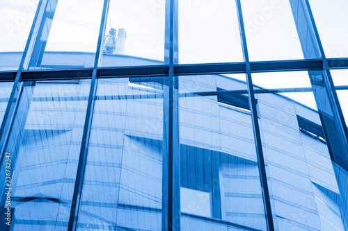 View from the large glass windows to the building with cellular repeaters on the roof - 236732347