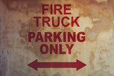 Old concrete wall with FIRE TRUCK PARKING ONLY inscription - 236733167
